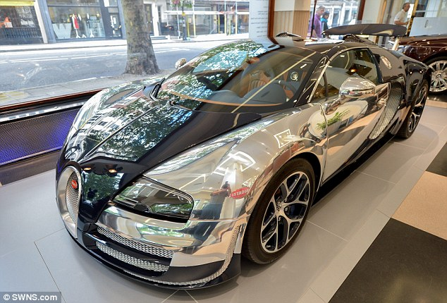 1408721438551_wps_4_The_Bugatti_Veyron_reflec